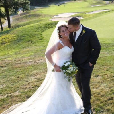 Couple kissing golf course